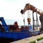 Self loading deck cargo barge with full revolving 126 t crane-